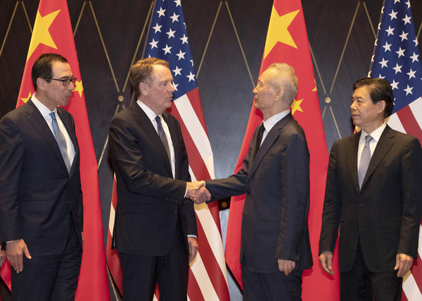 U.S. Trade Representative Robert Lighthizer (center left) shakes hands with Chinese Vice Premier Liu He at a conference center in Shanghai on July 31. Trade talks are expected to resume in September.