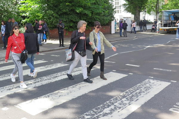 <em>World Cafe</em> Host Talia Schlanger on the iconic Abbey Road crosswalk with Beatles Tour Guide Richard Porter.