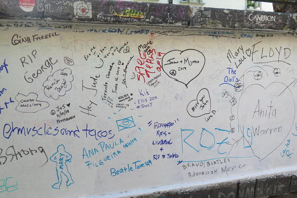 Fans leave love notes on the wall outside of Abbey Road Studios.