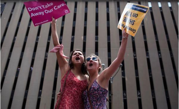 Juliana Hertel and Grace Hardison demonstrate against abortion restrictions during a Planned Parenthood rally in downtown St. Louis in June.