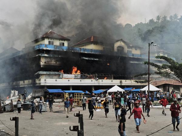 A local market is seen burning during a protest in Fakfak, West Papua, Indonesia, on Aug. 21. Violent protests this month were sparked by accusations that security forces had arrested Papuan students in East Java.