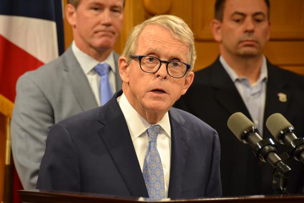 Gov. Mike DeWine unveils his background checks proposal at a Statehouse press conference.