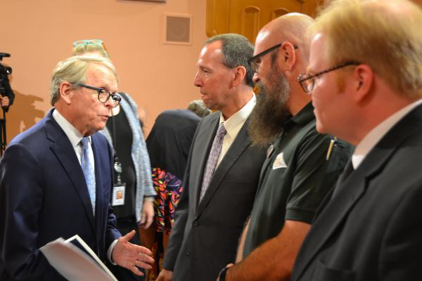 Gov. Mike DeWine meets with members of the Buckeye Firearms Association following his call for stronger database entry requirements.