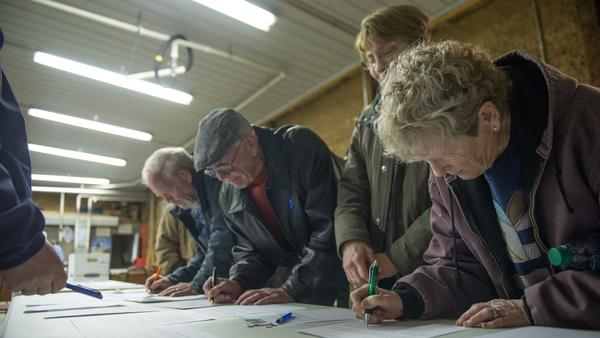 Participants sign in at a Democratic Party caucus at Jackson Township Fire Station in Keokuk, Iowa, on Feb. 1, 2016. The DNC has scrapped a virtual caucus plan for 2020.