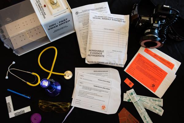 Materials from a sexual assault nurse examiner kit are spread out on a table at the YWCA in Oklahoma City. Swabs, photos, measurements and victim accounts of an incident are all part of the evidence collected by the specially trained nurses.