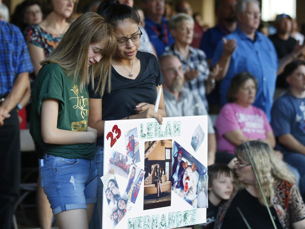 High school students Celeste Lujan, left, and Yasmin Natera mourn their friend, Leila Hernandez, one of the victims of the Saturday shooting rampage in West Texas.