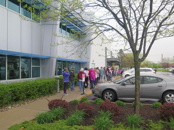 Lines have been reported at food pantries statewide, including this one at the Mid-Ohio Food Bank in April.