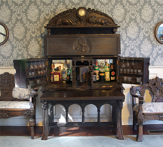 Lots of room for liquor in this hideaway cabinet design