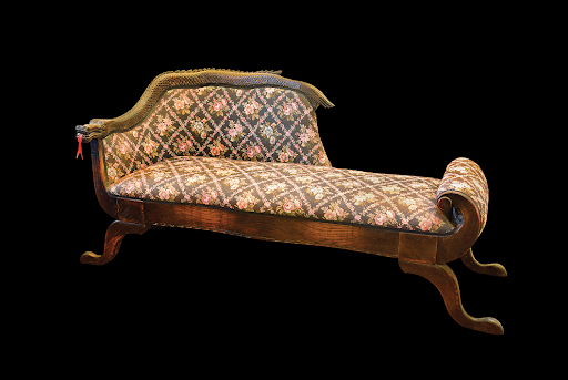 A chaise lounge topped with a dragon inspired by Stone's travels to Asia
