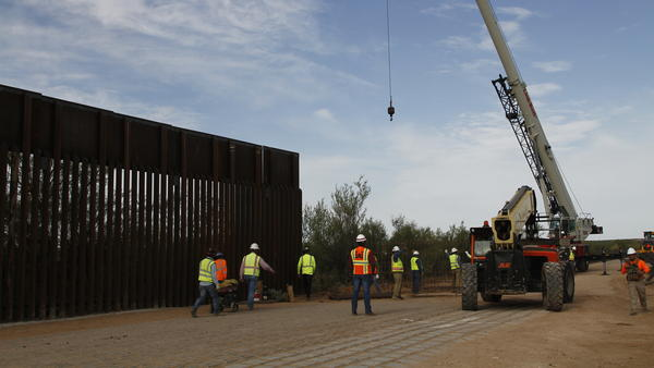 Workers break ground on new border wall construction about 20 miles west of Santa Teresa, N.M., last month. The Trump administration has started the arduous process of canceling $3.6 billion in military construction projects to fund its plans to build more of a wall along the U.S.-Mexico border.