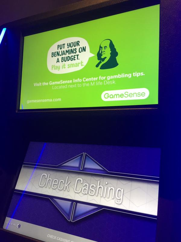 """An ad for """"GameSense"""" above an ATM at the MGM casino."""