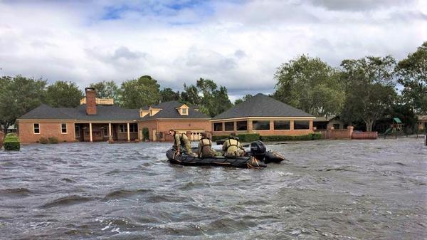 Florida National Guard soldiers going door to door in the Jacksonville area around Ortega Island following Hurricane Irma, Sept. 11, 2017.
