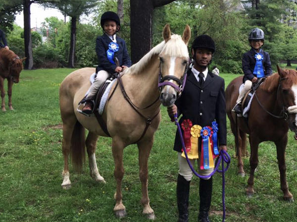 Schyler Smith, far left, Marc Harris and Shane Woodson are some of the younger members of Work to Ride in Philadelphia's Fairmount Park.