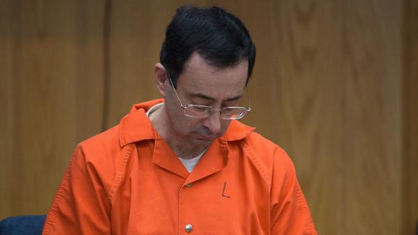Michigan State University and USA Gymnastics doctor Larry Nassar, seen at a sentencing hearing last year in Charlotte, Mich. On Thursday, the Department of Education fined the university $4.5 million for its response to Nassar's conduct while he was employed by the school.