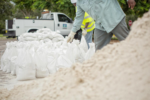 St. Petersburg workers fill sandbags in 2016 in preparation for storm flooding.