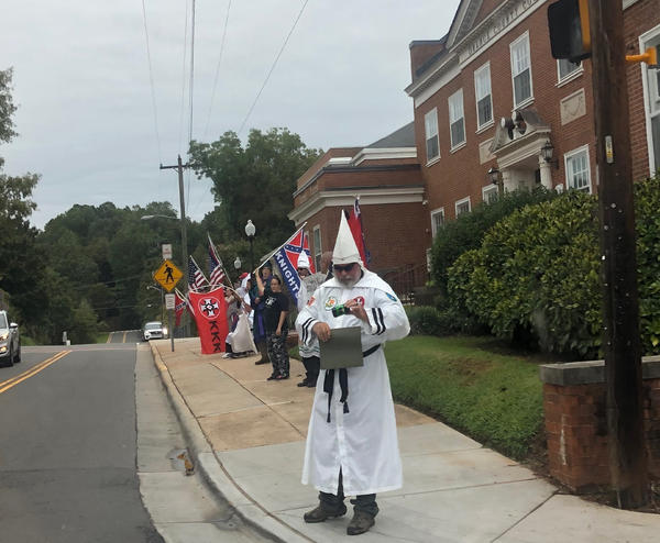 Klan members gathered in front of the Orange County Courthouse on August 24, 2019.