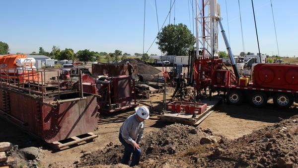 Mike Hickey works on capping an an orphaned well in Adams County, Colo. The EPA estimates there are more than 1 million abandoned gas and oil wells across the country.