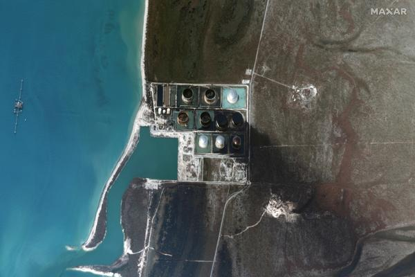 A satellite image taken Friday shows damage and oil leaking from a terminal on Grand Bahama. The company that owns it says 1.8 million barrels were being stored there when Hurricane Dorian hit late Sunday.