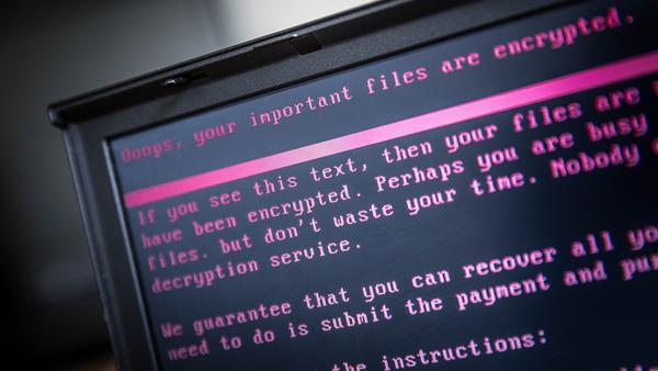 A laptop displays a message after being infected with ransomware.