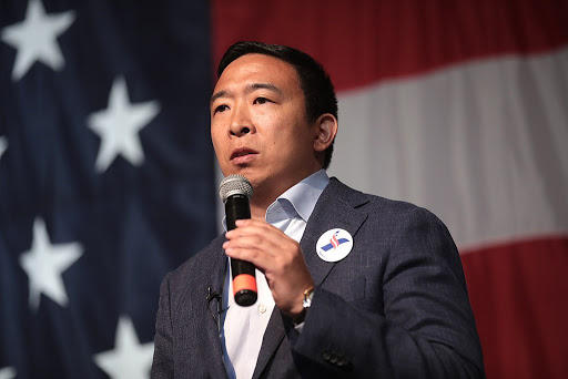 Andrew Yang speaking with attendees at the 2019 Iowa Democratic Wing Ding at Surf Ballroom in Clear Lake, Iowa.