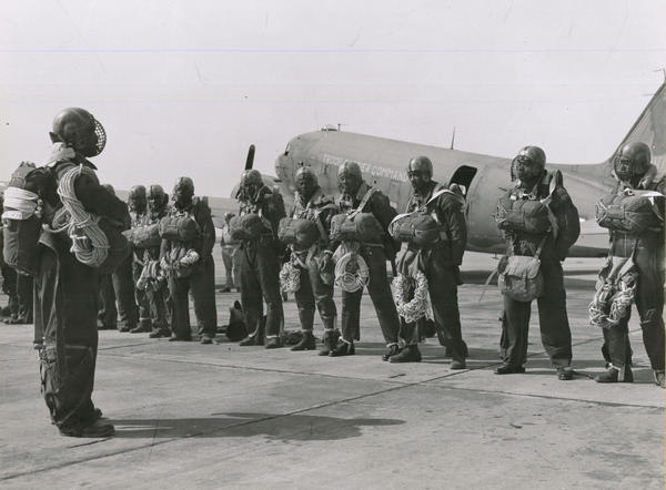 Paratroopers at Pendleton Army Airfield getting briefed before taking off to drop on a wildfire in the summer of 1945.