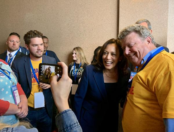 Sen. Kamala Harris poses for a selfie during the N.H. Democratic Party state convention.