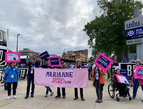 Marianne Williamson supporters outside the SNHU Arena in Manchester.