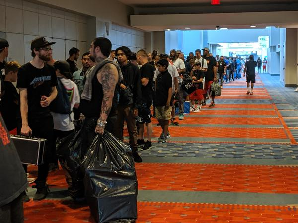 The line of attendees waiting to get in stretched down the hall, up the stairs, and outside the building. Sneaker Con organizers expect more than 10,000 people to show up to the event this weekend.