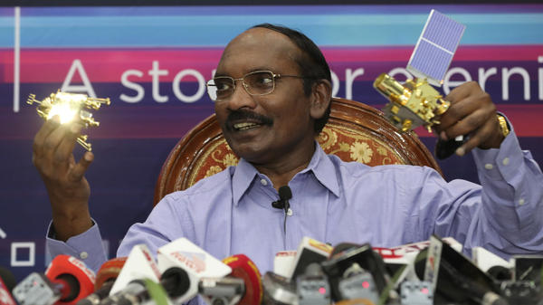 Indian Space Research Organization (ISRO) Chairman Kailasavadivoo Sivan displays a model of Chandrayaan 2 orbiter and rover during a press conference at their headquarters in Bangalore, India on Aug. 20.