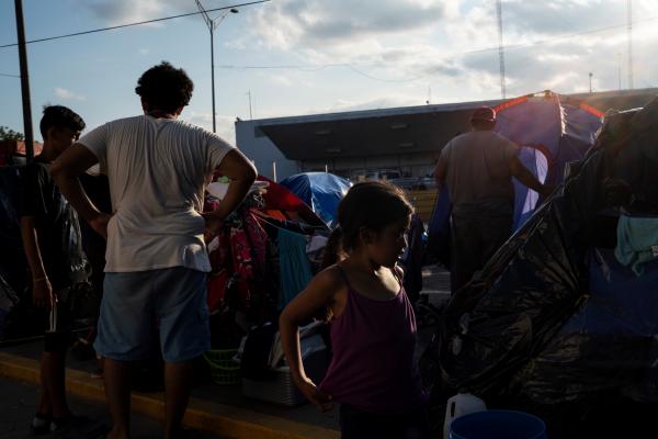Asylum seekers near the Gateway International Bridge in Matamoros.