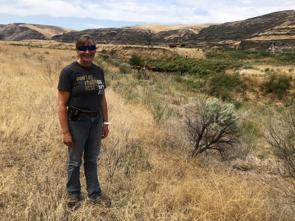 Rancher Molly Linville would like ranchers to be able to fight fires on their own property in Washington. She hopes the state will allow ranchers to form rangeland fire protection associations in areas where no agency is assigned to respond to wildland fi