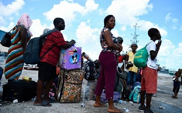 People await evacuation at a dock in Marsh Harbour, Bahamas, on Saturday in the aftermath of Hurricane Dorian.