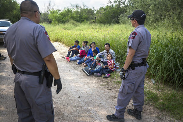Migrants from Honduras are apprehended after crossing the Rio Grande into the U.S., looking for asylum.