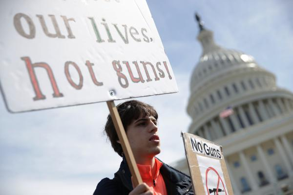 A high school student participates in a gun control rally in front of the U.S. Capitol in March. The U.S. House is taking up gun control measures after recent mass shootings, but it's not clear what the Senate or President Trump will accept.
