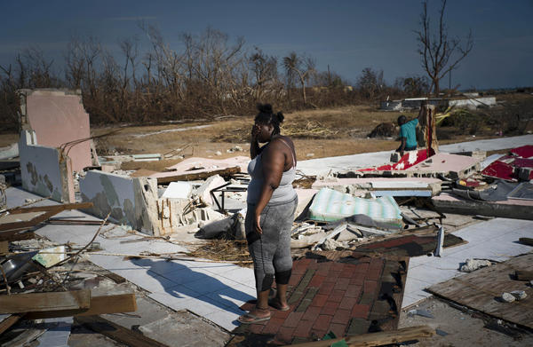 A woman is overcome as she surveys her destroyed home in High Rock, Grand Bahama, in the Bahamas last week in the wake of Hurricane Dorian.