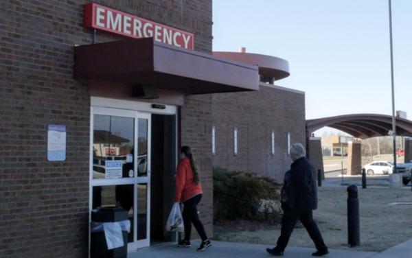 Visitors enter an emergency room at a rural Oklahoma hospital.