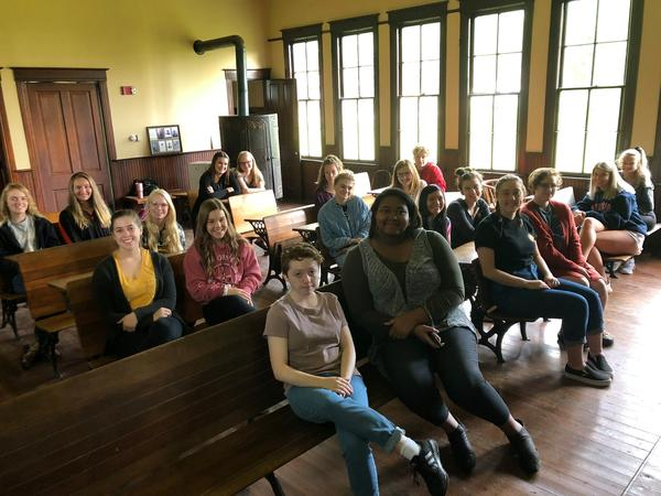 Unit 5 high schoolers on a recent field trip to the one-room schoolhouse on the west side of Illinois State University's campus.