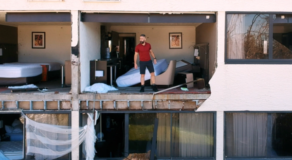 Josh Morgerman in a hotel damaged by a hurricane. (Photo courtesy of Discovery)