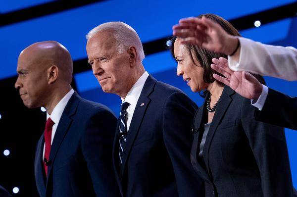 Democratic presidential hopefuls (from left): Sen. Cory Booker, D-N.J., former Vice President Joe Biden, and Sen. Kamala Harris, D-Calif., onstage before the July debate.