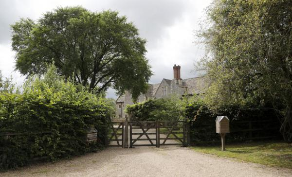 <p>A gate closes off a side entrance of the Rooksnest estate near Lambourn, England, Tuesday, Aug. 6, 2019. The property belongs to the Sackler family, owners of Purdue Pharma based in Stamford, Conn. A complex web of companies and trusts are controlled by the family, and an examination reveals links between far-flung holdings, far removed from the opioid manufacturer&rsquo;s headquarters in the U.S.</p>