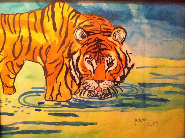Julian's great passions are art and animals. He loves to paint animals, like this tiger drinnking from a river.
