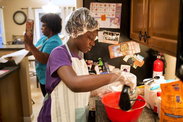 Tamia Coleman-Hawkins mixes batter for her signature chocolate chip cookies.