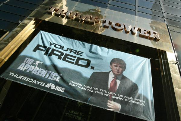 "A sign advertising the television show ""The Apprentice"" hangs at Trump Towers April 15, 2004 in New York City.  (Peter Kramer/Getty Images)"