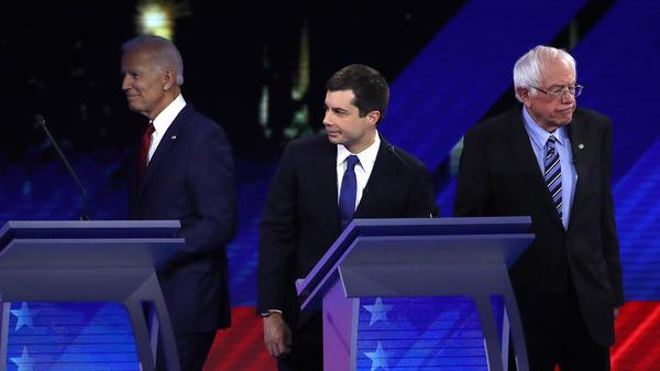Democratic presidential candidates former Vice President Joe Biden; South Bend, Ind., Mayor Pete Buttigieg; and Sen. Bernie Sanders of Vermont participate in Thursday's debate in Houston.