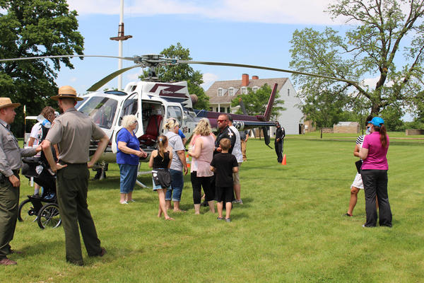 People gather around a medevac helicopter that flew to Fort Scott to promote medevac insurance.
