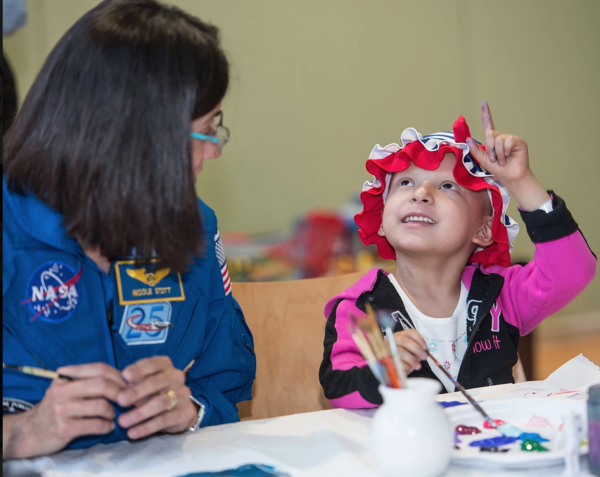 Former Astronaut Nicole Stott works on the Space Suit Art Project called Unity with a cancer patient from The University of Texas MD Anderson Cancer Center.