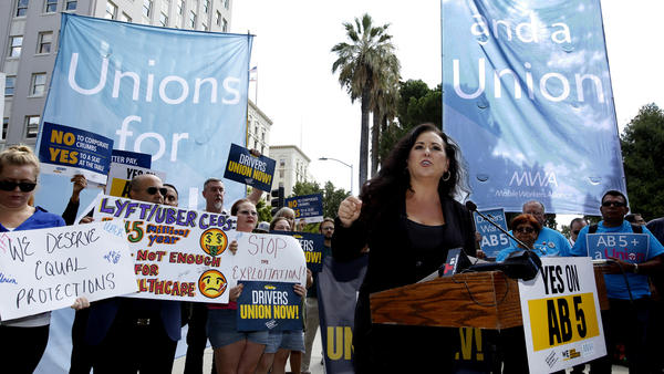 Assemblywoman Lorena Gonzalez, D-San Diego, speaks at an August 28 rally in Sacramento, Calif., calling for passage of AB5 to limit when companies can label workers as independent contractors.