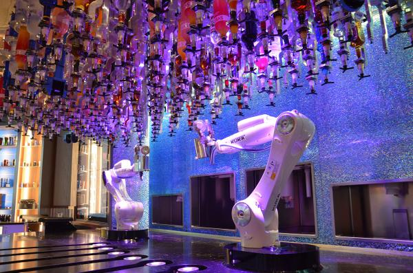 Automated robotic arms mix, shake and pour drinks at Tipsy Robot in Las Vegas.
