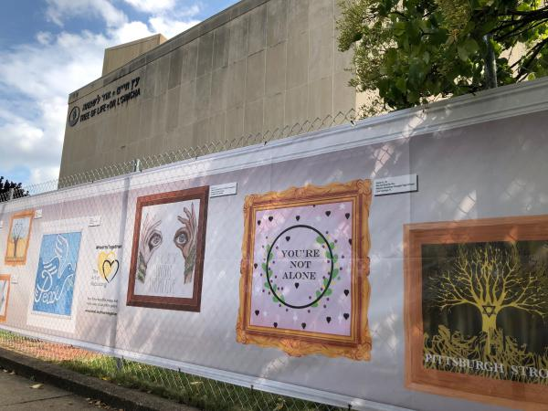 The fence in front of the Tree of Life synagogue has been decorated with 101 images from young people around the country and in New Zealand. It has been installed nearly one year after a mass shooting took place in the building.