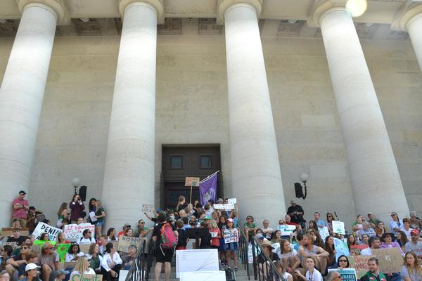Many students gather at the steps of the Ohio Statehouse in Columbus to call for action against climate change.